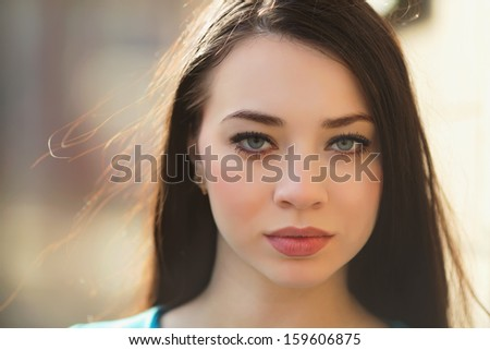 Portrait of sexy young brunette posing outdoors - stock photo