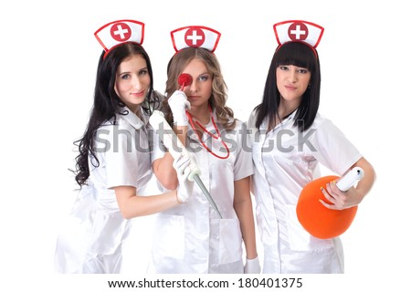 Portrait of sexy young nurses posing at camera - stock photo