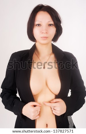 Portrait of sexy young woman at white background - stock photo