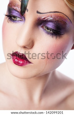 portrait of sexy young woman with creative makeup like in sixtieth - stock photo