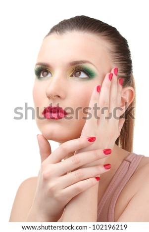 portrait of sexy young woman with glamour make up and red manicure