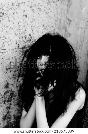 Portrait of shocked and scared goth girl. Black and white - stock photo