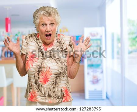 Portrait Of Shocked Senior Woman, indoors - stock photo