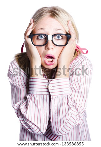 Portrait of shocked young business woman with head in hands, white background
