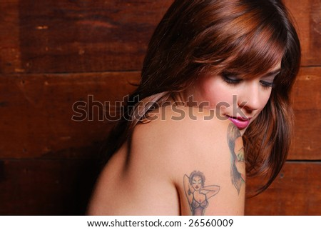 Portrait of shy nude caucasian woman inside barn - stock photo