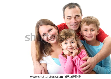 Portrait of siblings and their parents looking at camera - stock photo