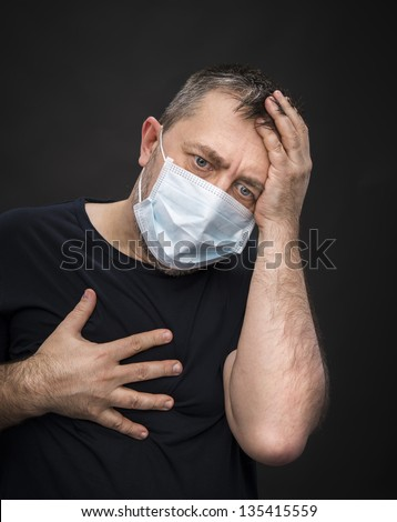Portrait of sick old man in medical mask - stock photo