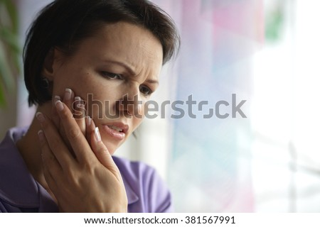 Portrait of Sick woman with tooth pain