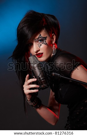 Portrait of singing woman with closed eyes - stock photo