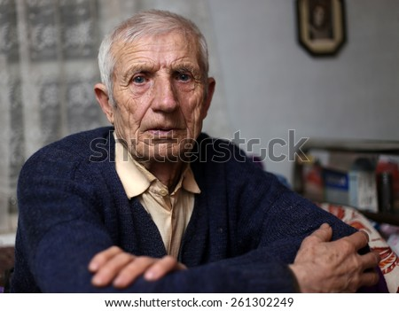portrait of  sitting senior man at home