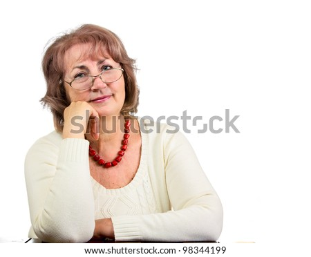 Portrait of sitting senior woman with glasses isolated on white - stock photo