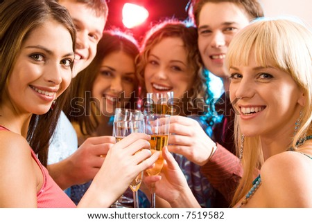 Portrait of six friends holding glasses of champagne