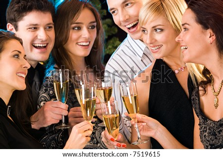 Portrait of six happy people holding glasses of champagne making a toast - stock photo