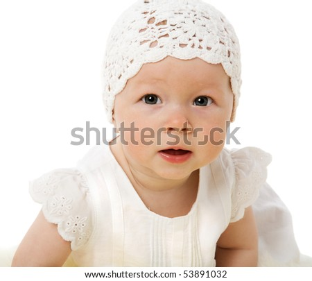 Portrait of Six month girl wearing white isolated on white