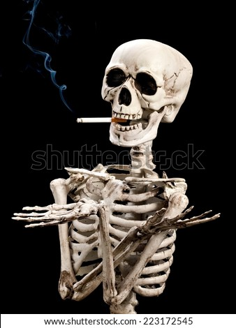 Portrait of skeleton with cigarette - stock photo