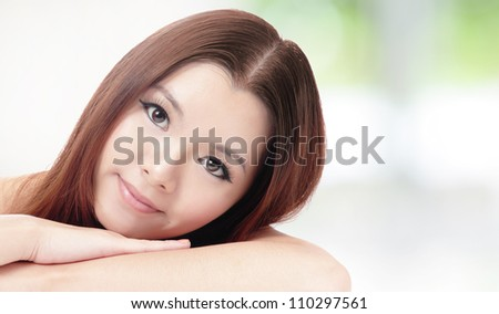 portrait of skincare woman smiling relax pose with nature green background, model is a asian girl - stock photo