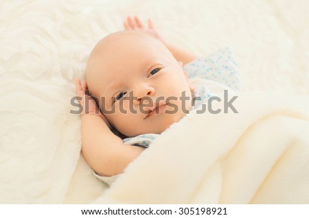 Portrait of sleep infant on the bed at home - stock photo