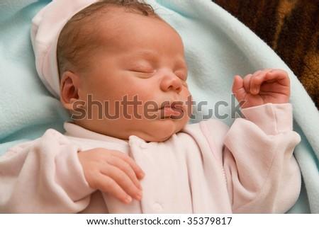 Portrait of sleeping baby boy lying on the bed - stock photo
