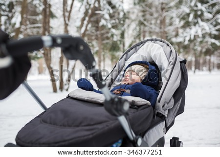 Portrait of sleeping baby in winter park