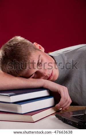 Portrait of sleeping student. Shot in studio. - stock photo