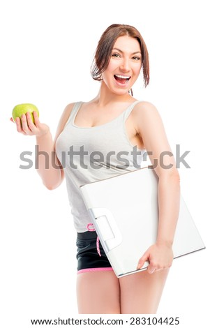 Portrait of slim girl with scales and apple