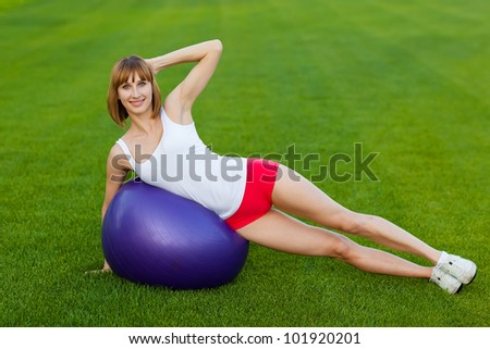 portrait of slim  woman making exercises on a fitball - stock photo