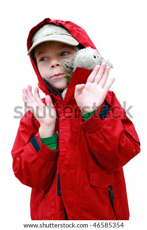 Portrait of small boy in red jacket with toy lambkin isolated on white with included clipping path - stock photo