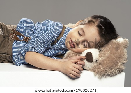 portrait of small boy sleep with bear - stock photo