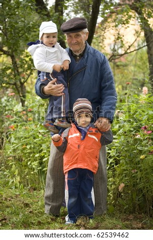 Portrait of small boys and old man  - Outdoor - stock photo