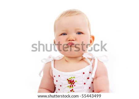 Portrait of small girl with capricious expression looking at camera - stock photo