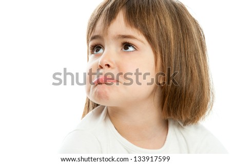 Portrait of small unhappy girl with funny face expression.Isolated. - stock photo
