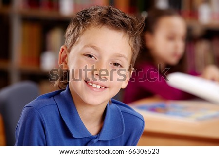 Portrait of smart lad looking at camera during lesson