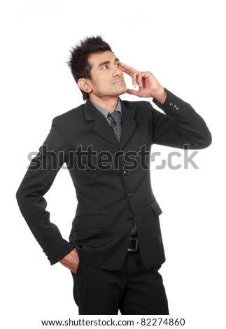 Portrait of smart young business man in a thought - stock photo