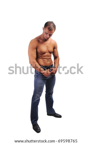 Portrait of smart young muscular man posing against white background