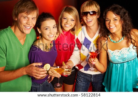 Portrait of smart young people looking at camera while toasting - stock photo