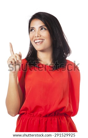 Portrait of smart young woman smiling happy and looks get an idea with hand pointing upward - stock photo