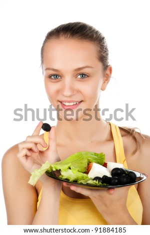 portrait of smile attractive young woman with plate of vegetable salad and olive, girl with greek salad, beauty woman with vegetarian salad, smiled face, white background - stock photo