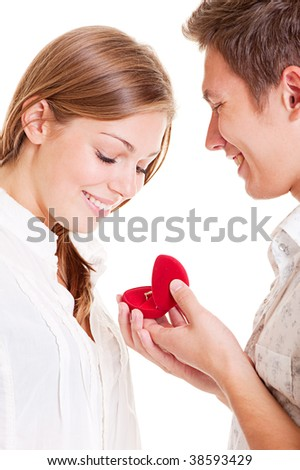 portrait of smiley couple with ring - stock photo