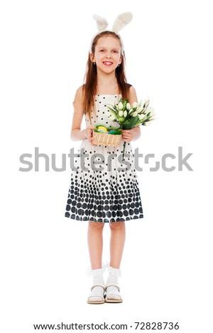 portrait of smiley girl with tulips and easter eggs - stock photo