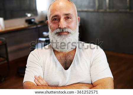 portrait of smiley senior man with beard and moustache - stock photo