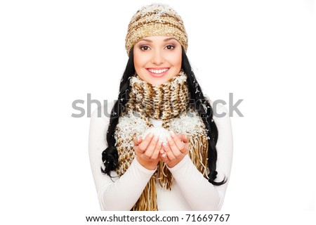 portrait of smiley woman with snow in her palm - stock photo