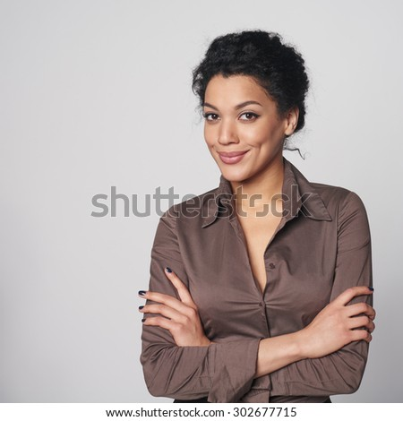 Portrait of smiling african american business woman looking confident and relaxed - stock photo