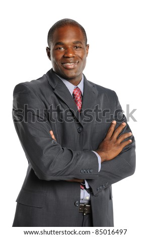 Portrait of smiling African American businessman isolated over white background