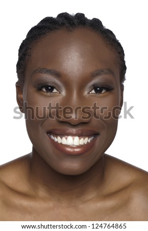 Portrait of smiling African woman against white background - stock photo