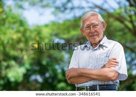 Portrait of smiling aged man looking at camera
