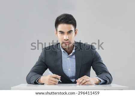 Portrait of smiling Asian businessman