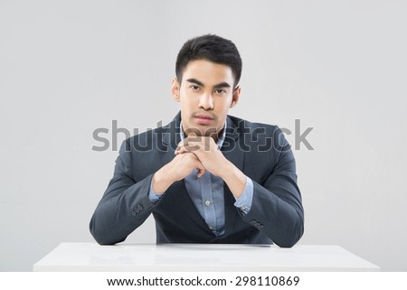 Portrait of smiling Asian businessman drawing in his notepad