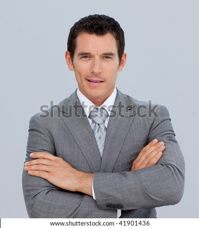 Portrait of smiling attractive businessman with folded arms - stock photo