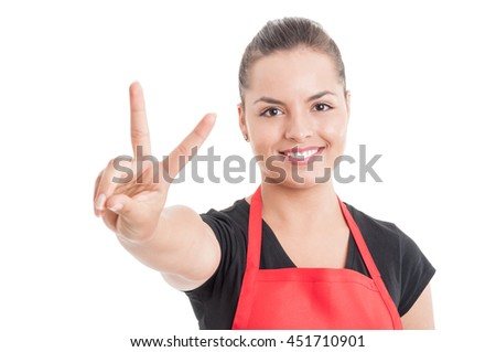 Portrait of smiling attractive female merchandiser on supermarket showing victory sign isolated on white background - stock photo