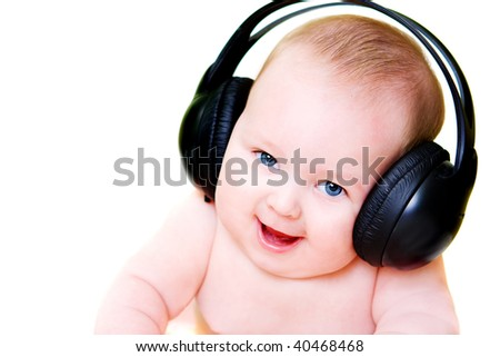 portrait of smiling baby in earphones isolated on white background